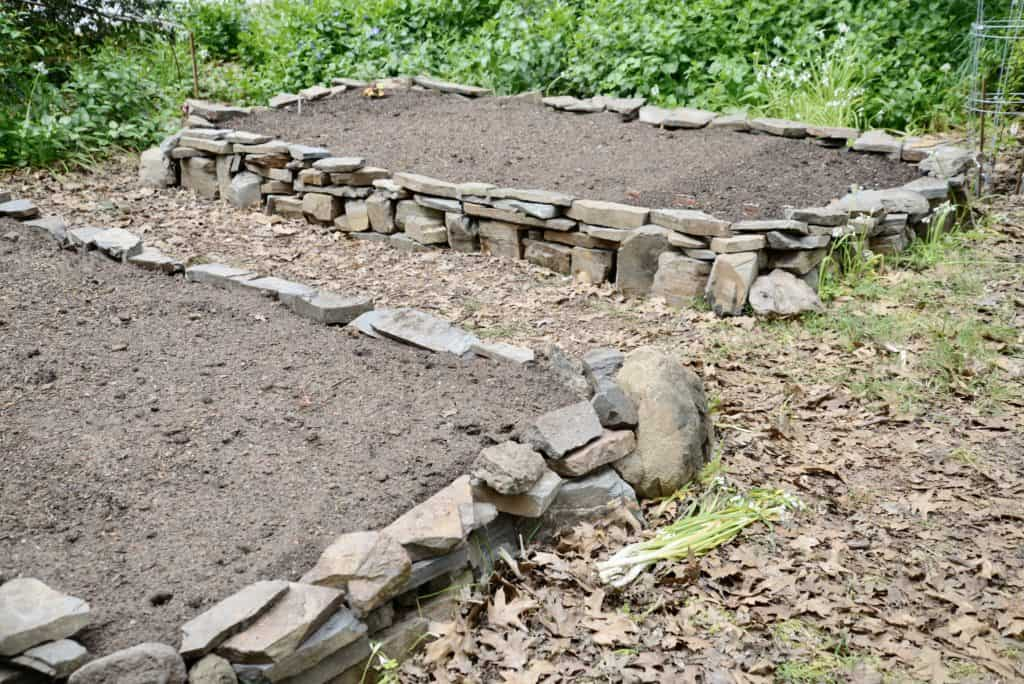 raised garden beds with rocks