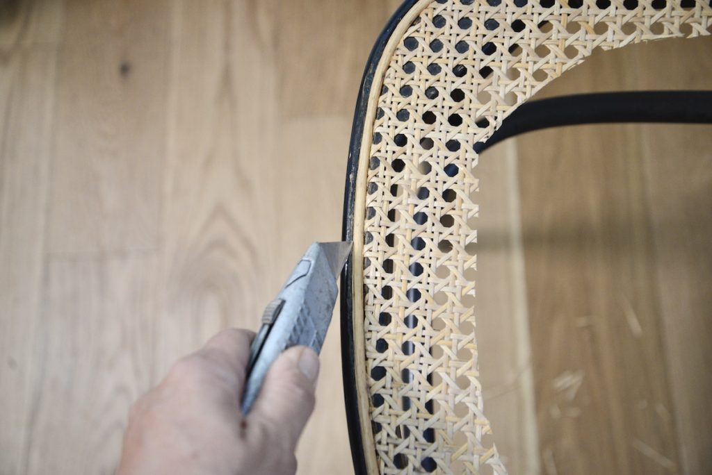 cutting the old spline of cane chair