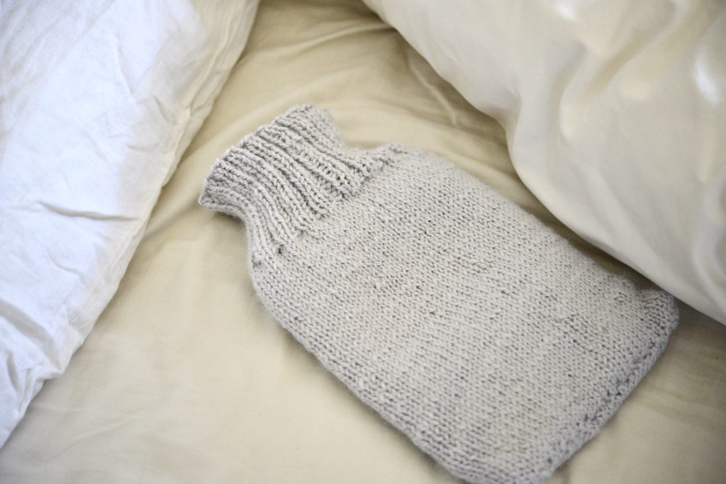 hot water bottle to stay warm in bed