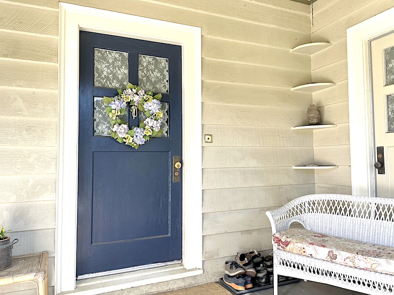 organized front porch with boot tray